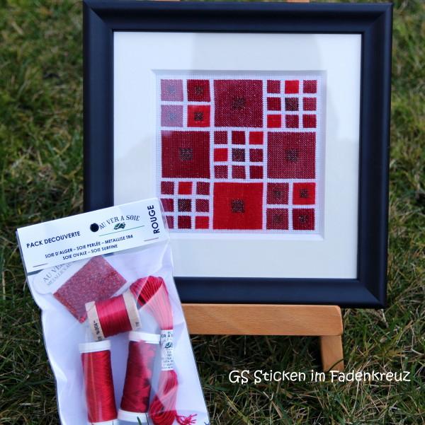 grafische Stickerei in rot